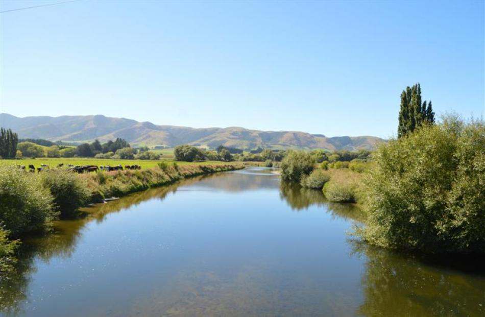 The Pomahaka River looking downstream from a bridge on State Highway 90 between Tapanui and...