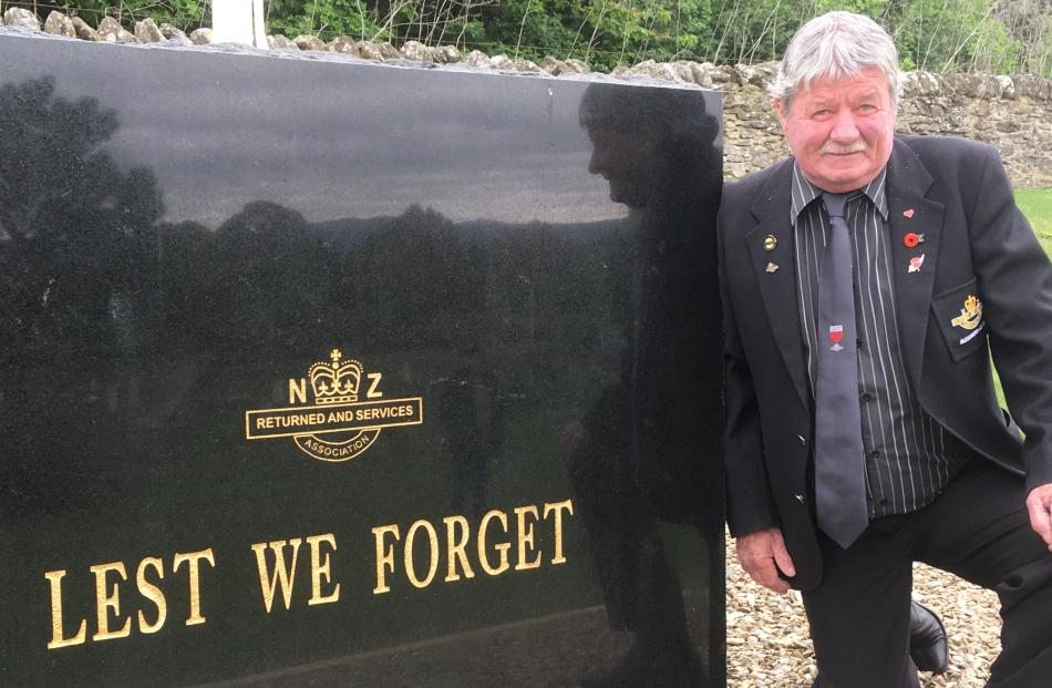 RSA Otago Southland District vice-president Kevin Harding admires a new plaque at Clyde Cemetery...