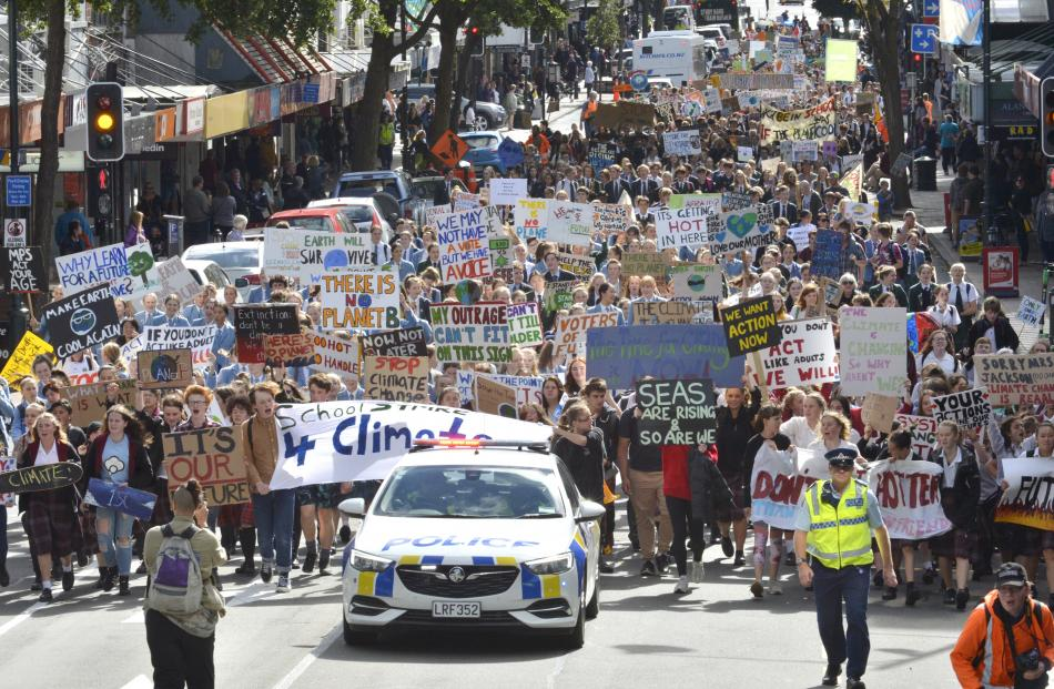 Thousands of protesters calling for action against climate change swarmed down George St in Dunedin today. Photo: Gerard O'Brien