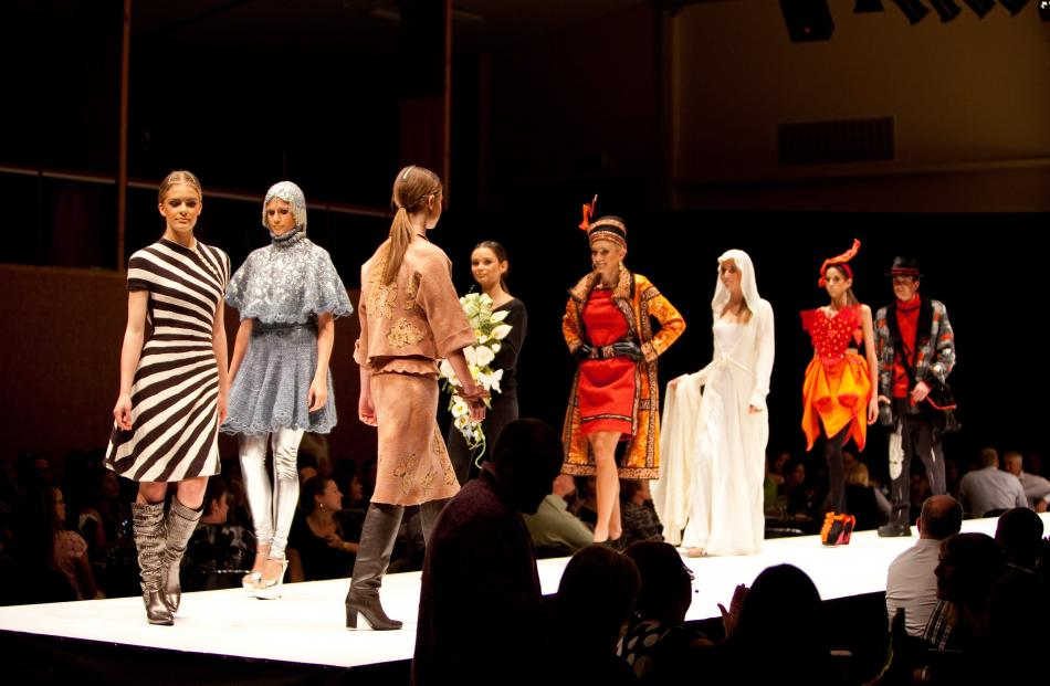 """Daphne Randle's """"Radiation"""" (left) parades the catwalk with other category winners at the 2013..."""