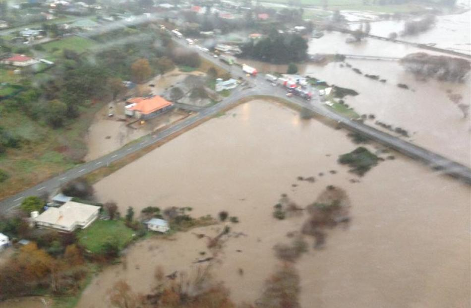 Traffic on SH 1 is stopped at Maheno just south of the Kakanui River bridge (centre right) when...