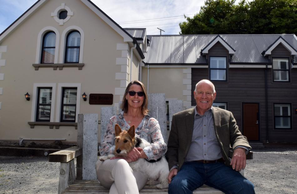 The Stables owners Caryn Bouton and Malcolm McDonald and her foxy-cross dog Dexter relax at the...