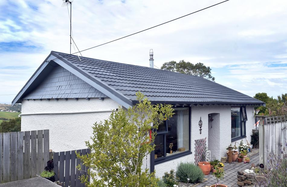 The roughcast bungalow was built in the 1930s.