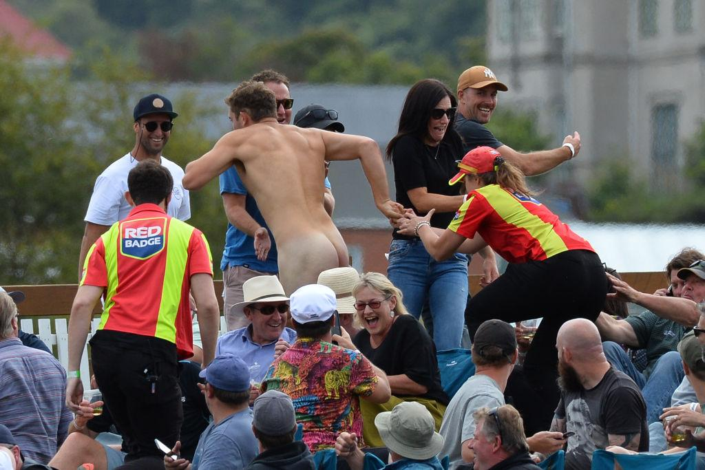Members of the ground security try to catch a streaker during the second Twenty20 international...