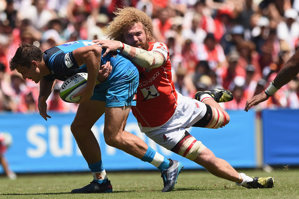 Matt Duffie of the Blues is tackled by Willie Britz of the Sunwolves. Photo: Getty