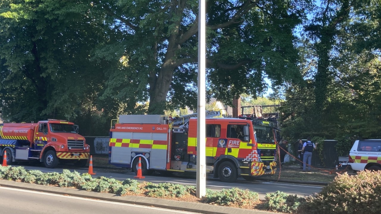 Firefighters at the Fendalton house this morning. Photo: Geoff Sloan