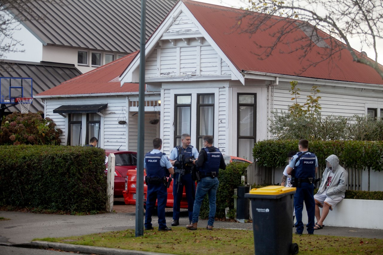 Police outside the Clissold St house in Merivale. Photo: Geoff Sloan