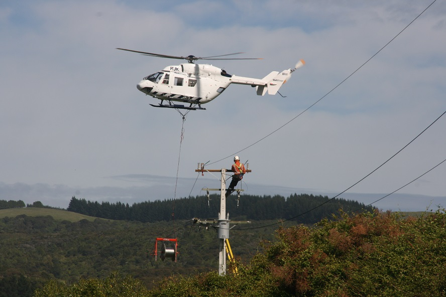 Some precision flying by Hele Otago during Unison Contracting's power line replacement works at...