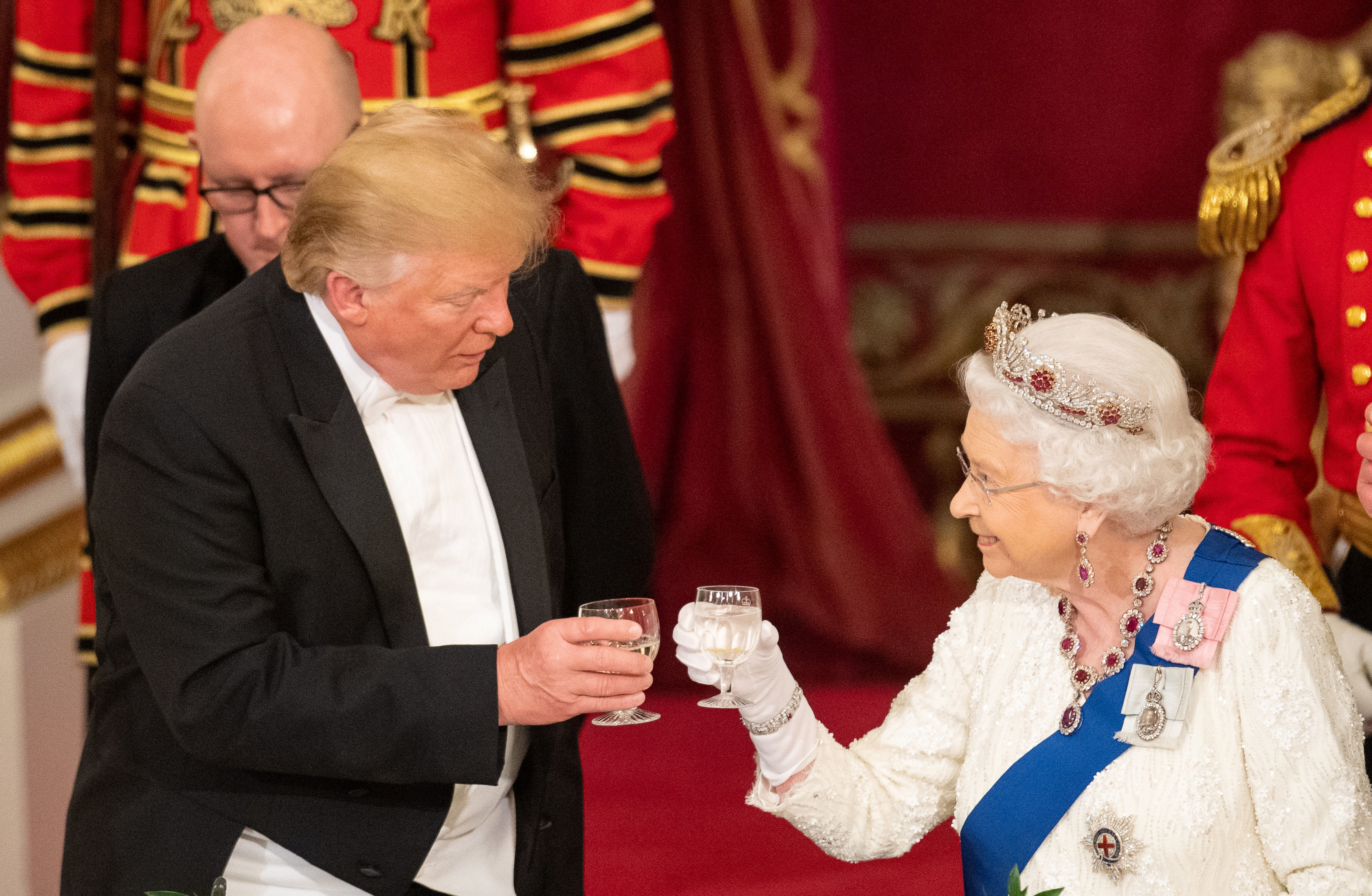 Donald Trump and the Queen raise their glasses to make a toast at the State Banquet at Buckingham...