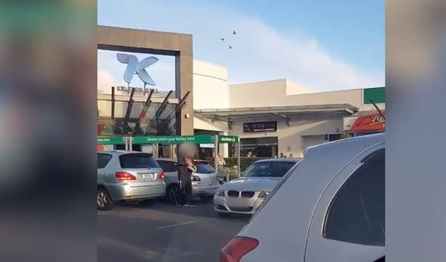 A man is seen throwing eggs at a vehicle outside a shopping centre in Kelston, West Auckland....