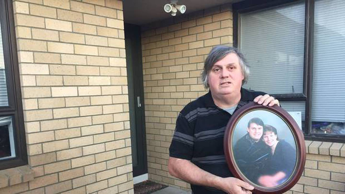 Laurie Anderson holds a photo of him with partner Angela Blackmoore who was murdered in 1995 just...