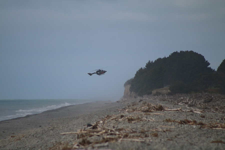Helicopters assisted with the search at the river mouth this morning. Photos: Kayla Hodge
