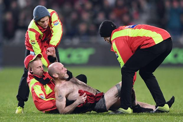 A streaker is stopped by security during the round 5 Super Rugby Aotearoa match between the...