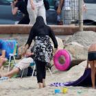 A woman wears a burkini on a beach in Marseille, France. Photo Reuters