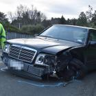 A Dunedin police officer marks the final resting place of a car involved in several accidents in...